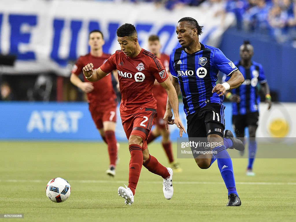 Justin Morrow #2 of the Toronto FC plays the ball past Didier Drogba #11 of the Montreal Impact during leg one of the MLS Eastern Conference finals at Olympic Stadium on November 22, 2016 in Montreal, Quebec, Canada. The Montreal Impact defeated the Toronto FC