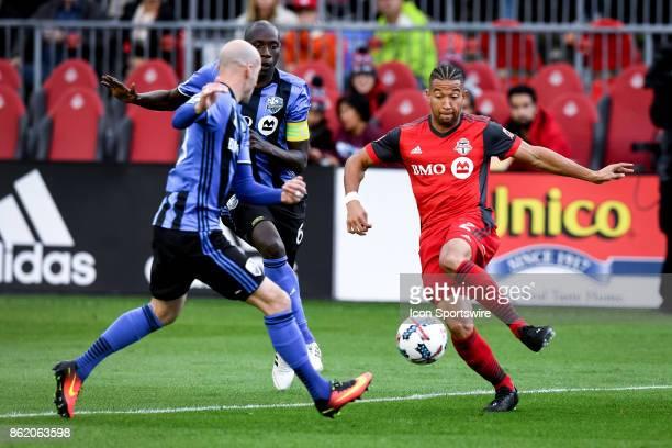 Justin Morrow of Toronto FC dribbles past Hassoun Camara of Montreal Impact during the first half of the MLS Soccer regular season game between...