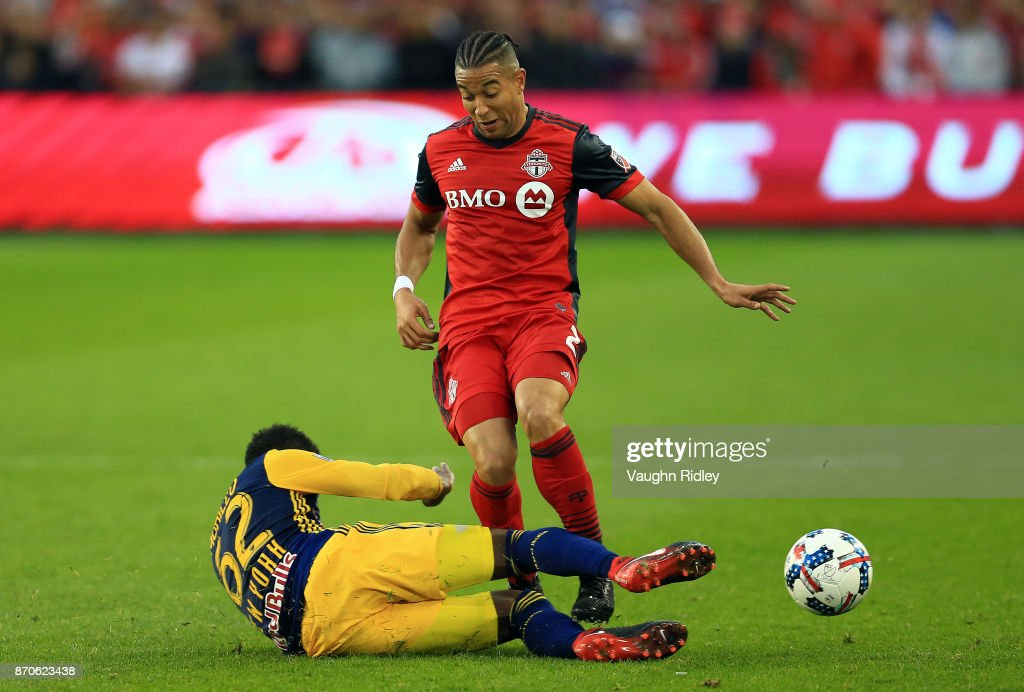Justin Morrow #2 of Toronto FC is tackled by Michael Amir Murillo #62 of New York Red Bulls during the first half of the MLS Eastern Conference Semifinal, Leg 2 game at BMO Field on November 5, 2017 in Toronto, Ontario, Canada.