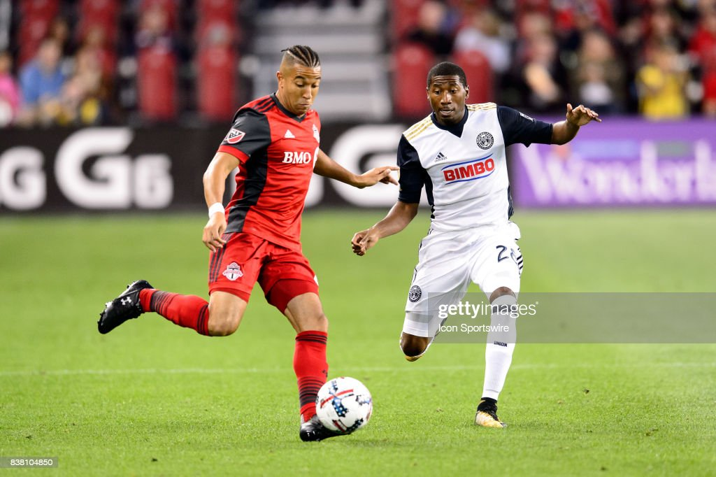 Justin Morrow (2) of Toronto FC passes the ball away from Ray Gaddis (28) of Philadelphia Union during the first half of the MLS Soccer regular season game between Toronto FC and Philadelphia Union on August 23, 2017, at BMO Field in Toronto, ON, Canada.