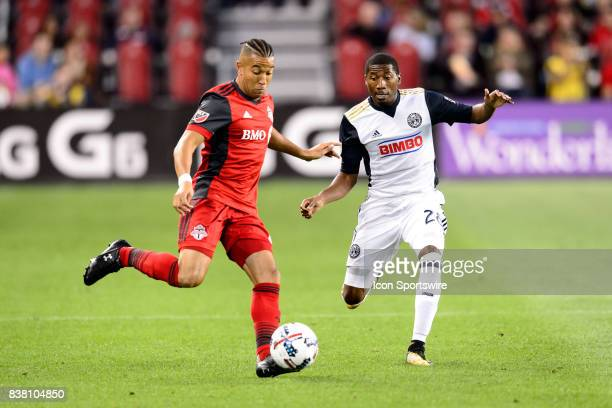 Justin Morrow of Toronto FC passes the ball away from Ray Gaddis of Philadelphia Union during the first half of the MLS Soccer regular season game...