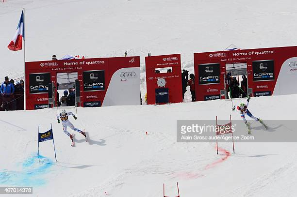 Justin Murisier of Switzerland competes against Mattias Hargin of Sweden during the Audi FIS Alpine Ski World Cup Finals Nations Team Event on March...