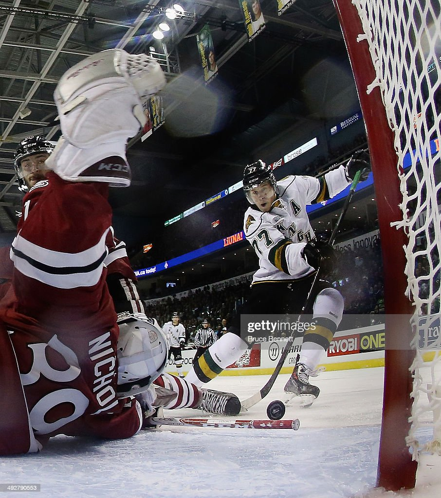Justin Nichols #39 of the Guelph Storm stops Josh Anderson #77 of the London Knights during the 2014 Memorial Cup tournament at Budweiser Gardens on May 21, 2014 in London, Ontario, Canada. The Storm defeated the Knights 7-2.
