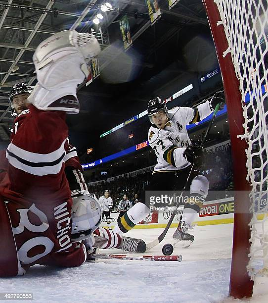 Justin Nichols of the Guelph Storm stops Josh Anderson of the London Knights during the 2014 Memorial Cup tournament at Budweiser Gardens on May 21...