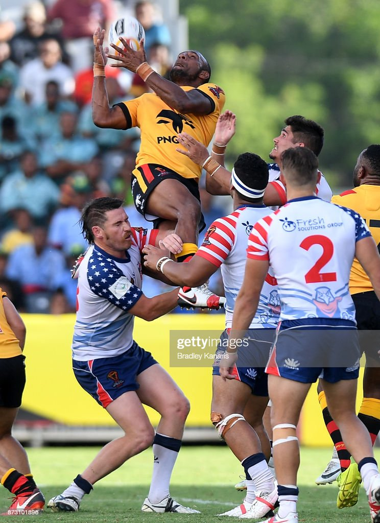 Justin Olam of Papua New Guinea takes a catch during the 2017 Rugby League World Cup match between Papua New Guinea and the United States on November 12, 2017 in Port Moresby, Papua New Guinea.