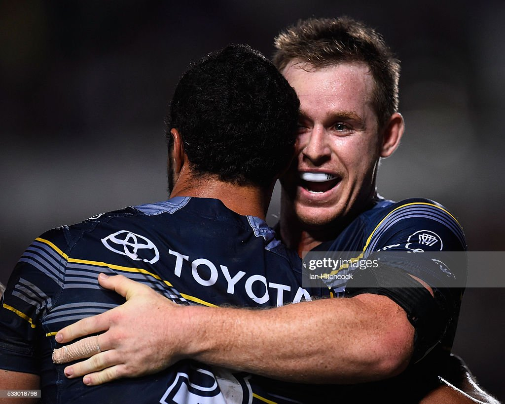 Justin O'Neil of the Cowboys celebrates after scoring a try with Michael Morgan during the round 11 NRL match between the North Queensland Cowboys and the Brisbane Bronocs at 1300SMILES Stadium on May 20, 2016 in Townsville, Australia.