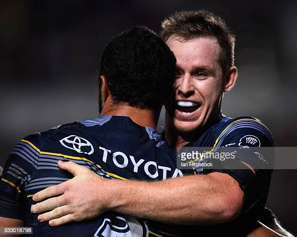 Justin O'Neil of the Cowboys celebrates after scoring a try with Michael Morgan during the round 11 NRL match between the North Queensland Cowboys...