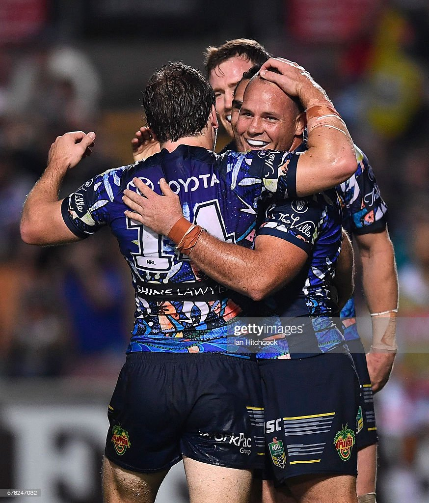 Justin O'Neil of the Cowboys celebrates after scoring a try with Matthew Scott, Rory Kostjasyn and Gavin Cooper of the Cowboys during the round 20 NRL match between the North Queensland Cowboys and the Canterbury Bulldogs at 1300SMILES Stadium on July 21, 2016 in Townsville, Australia.