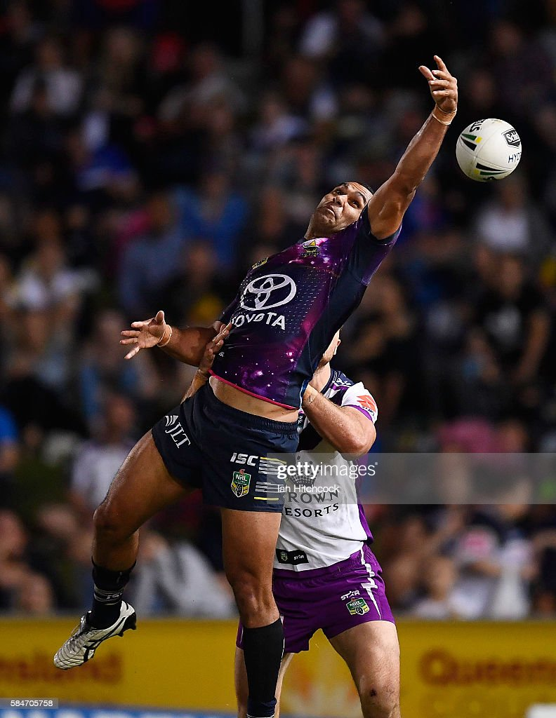 Justin O'Neil of the Cowboys contests a high ball during the round 21 NRL match between the North Queensland Cowboys and the Melbourne Storm at 1300SMILES Stadium on July 30, 2016 in Townsville, Australia.