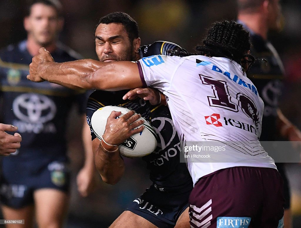 Justin O'Neil of the Cowboys is tackled by Martin Taupau of the Sea Eagles during the round 16 NRL match between the North Queensland Cowboys and the Manly Sea Eagles at 1300SMILES Stadium on June 27, 2016 in Townsville, Australia.