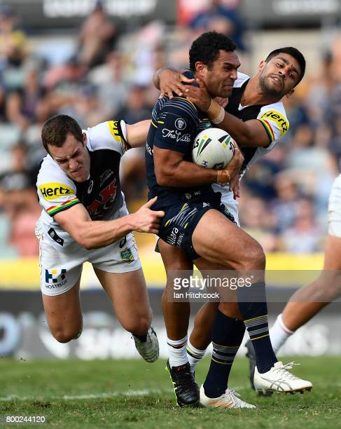 Justin O'Neil of the Cowboys is wrapped up by the Panthers defence during the round 16 NRL match between the North Queensland Cowboys and the Penrith...