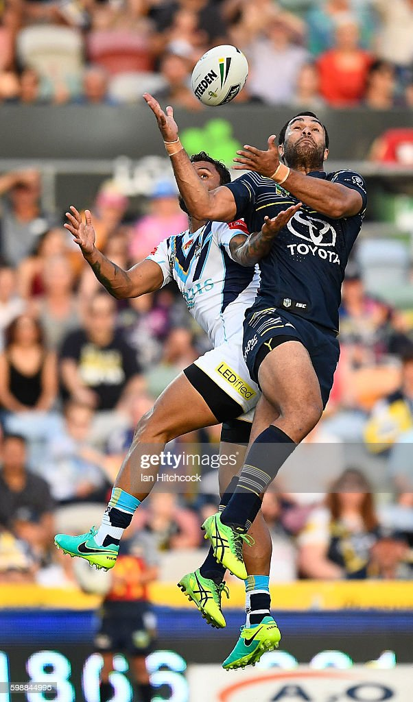 Justin O'Neil of the Cowboys takes a high ball in front of Josh Hoffman of the Titans during the round 26 NRL match between the North Queensland Cowboys and the Gold Coast Titans at 1300SMILES Stadium on September 3, 2016 in Townsville, Australia.
