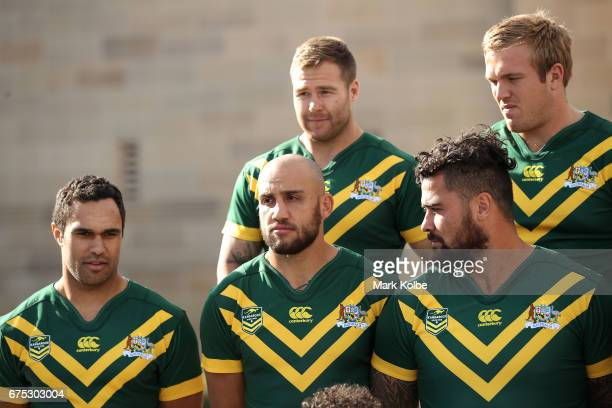 Justin O'Neill Blake Ferguson Trent Merrin Andrew Fifita and Jake Trbojevic watch on as they prepare for the team photo during an Australian...