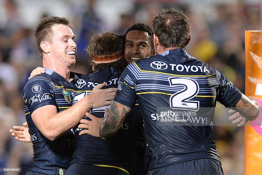Justin O'Neill of the Cowboys is congratulated by team mates after scoring a try during the first NRL semi final between North Queensland Cowboys and Brisbane Brisbane at 1300SMILES Stadium on September 16, 2016 in Townsville, Australia.