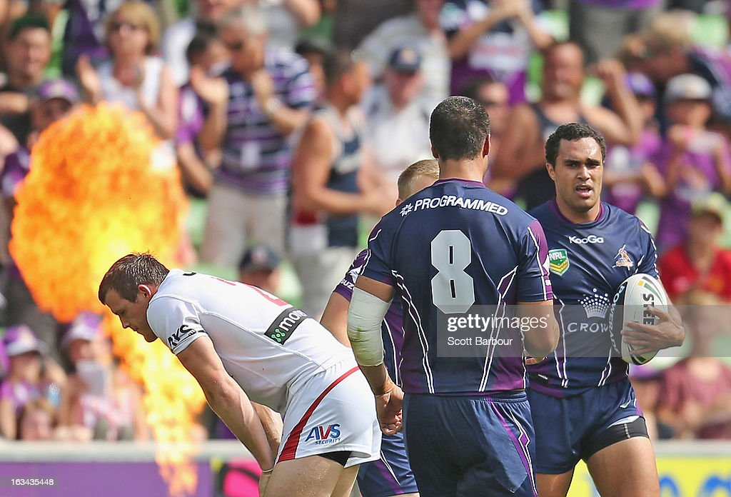 Justin O'Neill (R) of the Storm is congratulated by his team mates after scoring a try during the round one NRL match between the Melbourne Storm and the St George Illawarra Dragons at AAMI Park on March 10, 2013 in Melbourne, Australia.