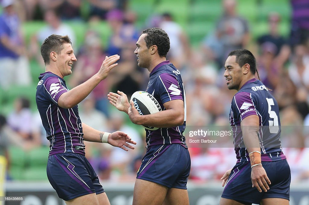 Justin O'Neill (C) of the Storm is congratulated by his team mates after scoring a try during the round one NRL match between the Melbourne Storm and the St George Illawarra Dragons at AAMI Park on March 10, 2013 in Melbourne, Australia.