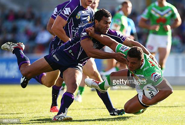 Justin O'Neill of the Storm tackles Josh Papalii of the Raiders during the round seven NRL match between the Canberra Raiders and the Melbourne Storm...