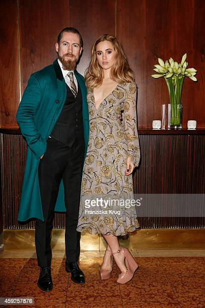 Justin O'Shea and Suki Waterhouse attend the mytheresacom X Burberry Dinner on November 19 2014 in Munich Germany