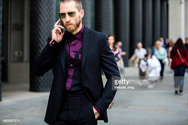 Justin O'Shea of MyTheresa wears a black purple and blue fitted suit during London Fashion Week Spring Summer 2016 at King's Cross on September 19...