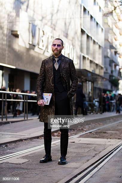 Justin O'Shea of MyTheresa wears a paisley print Etro coat over a suit during the Milan Men's Fashion Week Fall/Winter 2016/17 on January 16 2016 in...