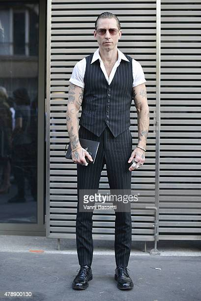 Justin O'Shea poses before the Saint Laurent show at the Carreau du Temple on June 28 2015 in Paris France