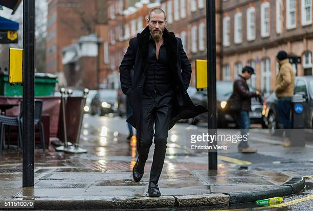 Justin O'Shea wearing a black wool coat and shirt seen outside during London Fashion Week Autumn/Winter 2016/17 on February 20 2016 in London England