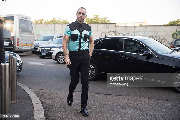 Justin O'Shea wears a black and teal bowling shirt during the Milan Fashion Week Spring/Summer 16 on September 26 2015 in Milan Italy