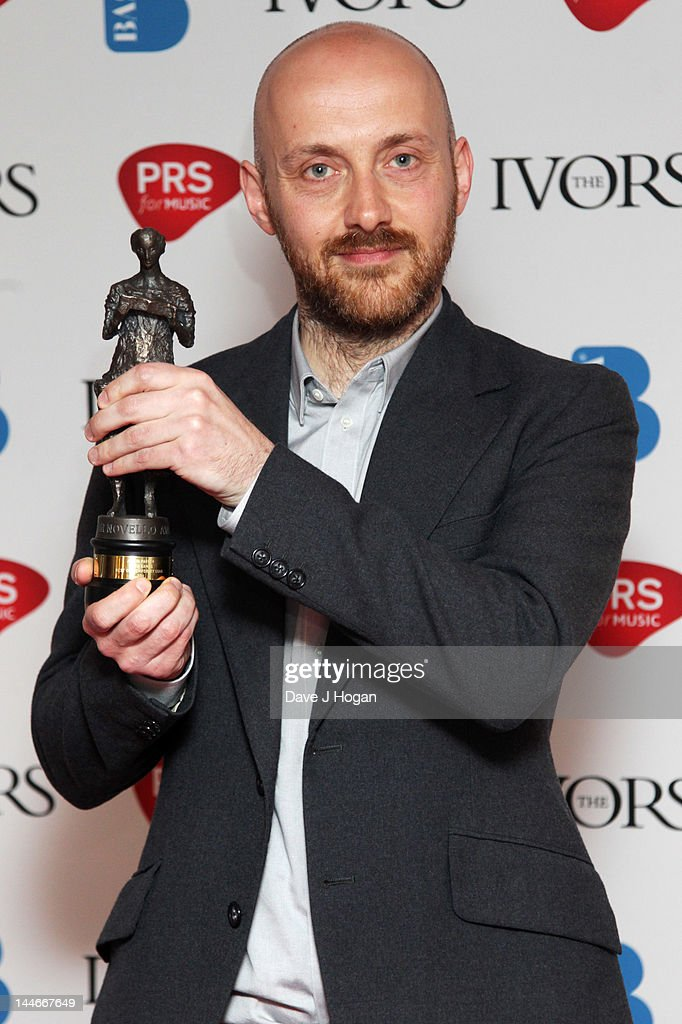 Justin Parker poses with his Best Contempory Song Award in the press room at the Ivor Novello Awards 2012 at Grosvenor House on May 17, 2012 in London, England.