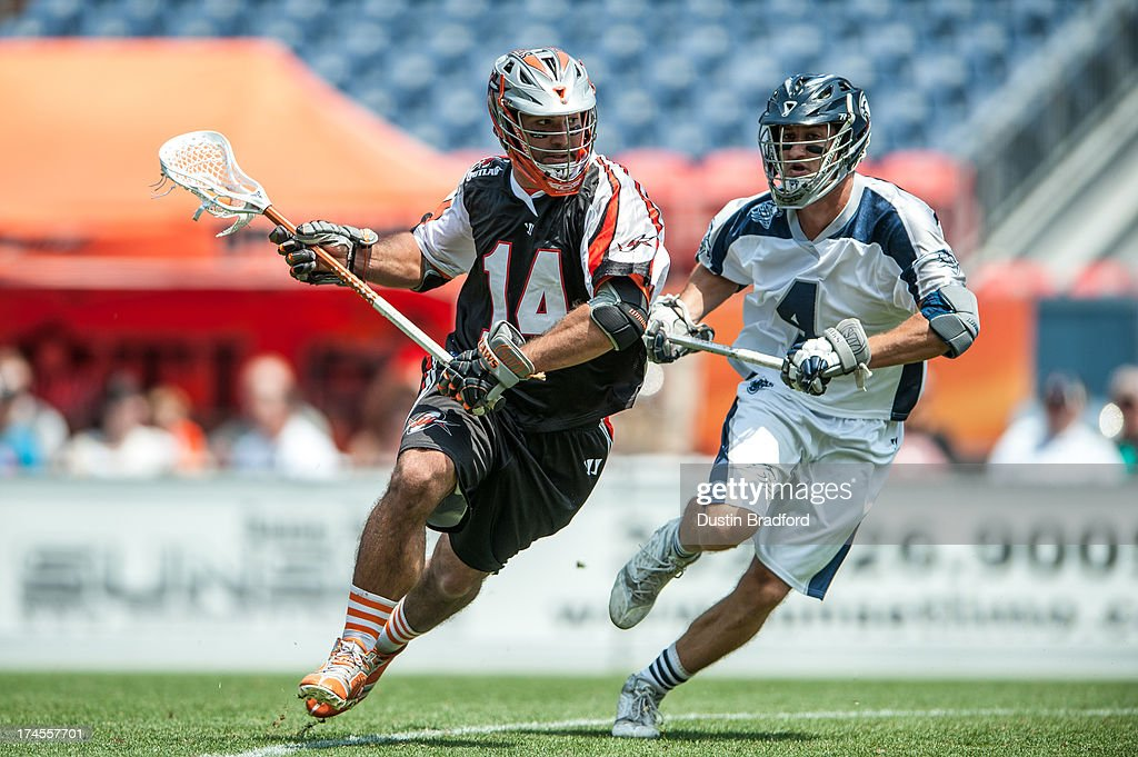Justin Pennington #14 of the Denver Outlaws is covered by Dan Burns #4 of the Chesapeake Bayhawks during a Major League Lacrosse game at Sports Authority Field at Mile High on July 27, 2013 in Denver, Colorado. The Outlaws beat the Bayhawks 14-12.