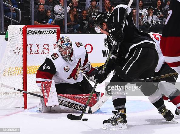Justin Peters of the Arizona Coyotes makes a save against Tanner Pearson of the Los Angeles Kings on September 26 2016 at Staples Center in Los...