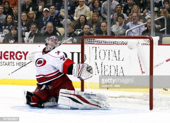 Justin Peters of the Carolina Hurricanes can't stop the puck on James Neal of the Pittsburgh Penguins hat trick goal in the third period during the...