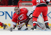 Justin Peters of the Carolina Hurricanes eyes a Buffalo Sabres shot as it heads toward the crease during an NHL game on March 5 2013 at PNC Arena in...