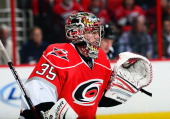 Justin Peters of the Carolina Hurricanes focuses before a faceoff during an NHL game against the Buffalo Sabres on March 5 2013 at PNC Arena in...