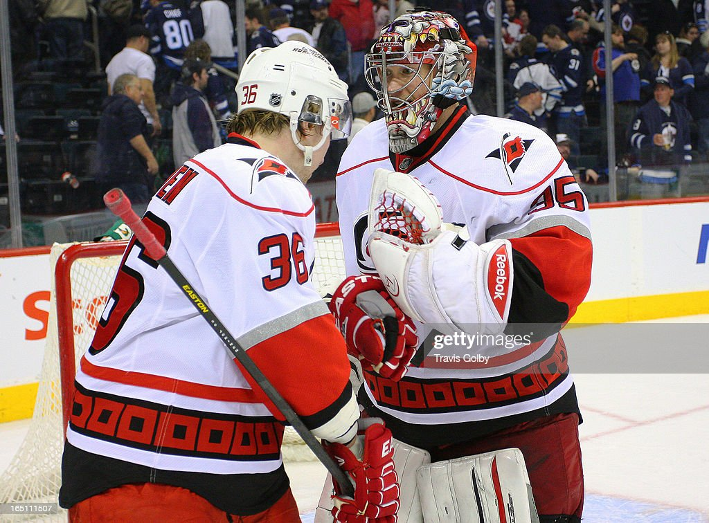 Justin Peters #35 of the Carolina Hurricanes gets congratulated by teammate <a gi-track='captionPersonalityLinkClicked' href=/galleries/search?phrase=Jussi+Jokinen&family=editorial&specificpeople=570599 ng-click='$event.stopPropagation()'>Jussi Jokinen</a> #36 after backstopping the Hurricanes to a 3-1 victory over the Winnipeg Jets at the MTS Centre on March 30, 2013 in Winnipeg, Manitoba, Canada.