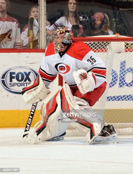 Justin Peters of the Carolina Hurricanes gets ready to make a save against the Phoenix Coyotes at Jobingcom Arena on December 14 2013 in Glendale...