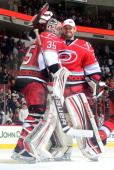 Justin Peters of the Carolina Hurricanes is congratulated by Dan Ellis following the team's 43 victory over the Buffalo Sabres on March 5 2013 at PNC...