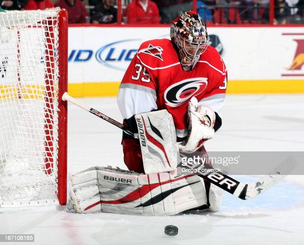 Justin Peters of the Carolina Hurricanes makes a pad save during an NHL game against the Philadelphia Flyers at PNC Arena on April 20 2013 in Raleigh...