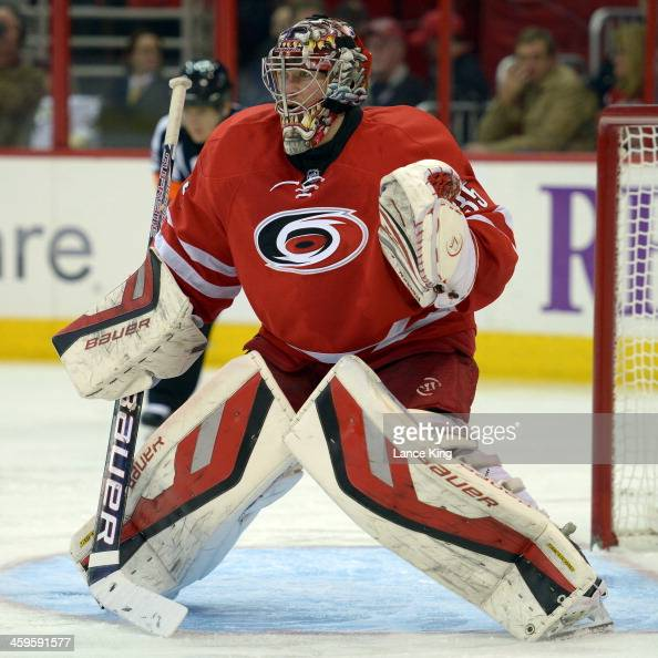 Justin Peters of the Carolina Hurricanes protects the net against the Pittsburgh Penguins at PNC Arena on December 27 2013 in Raleigh North Carolina...