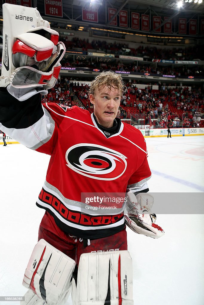 Justin Peters #35 of the Carolina Hurricanes salutes the crowd following the team's 4-2 victory over the Boston Bruins at PNC Arena on April 13, 2013 in Raleigh, North Carolina.
