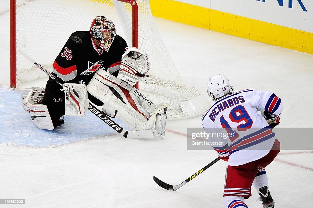 Justin Peters #35 of the Carolina Hurricanes, who replaced starting goalkeeper Dan Ellis #31 in the third period, stops a shot by <a gi-track='captionPersonalityLinkClicked' href=/galleries/search?phrase=Brad+Richards&family=editorial&specificpeople=202622 ng-click='$event.stopPropagation()'>Brad Richards</a> #19 of the New York Rangers during play at PNC Arena on April 6, 2013 in Raleigh, North Carolina. The Rangers won 4-1.