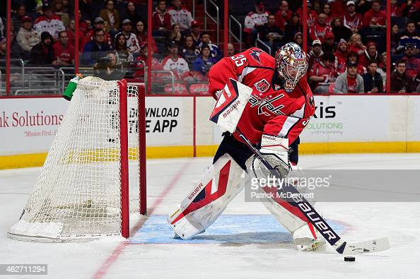 Justin Peters of the Washington Capitals controls the puck against the St Louis Blues in the first period during an NHL game at Verizon Center on...