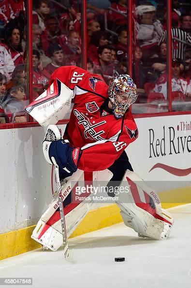 Justin Peters of the Washington Capitals controls the puck behind his net in the first period against the Florida Panthers during an NHL game at...