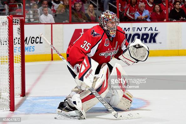 Justin Peters of the Washington Capitals in action in the third period against the Florida Panthers during an NHL game at Verizon Center on October...