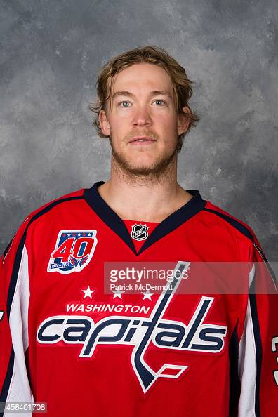 Justin Peters of the Washington Capitals poses for his official headshot for the 20142015 season on September 18 2014 at the Kettler Capitals Iceplex...