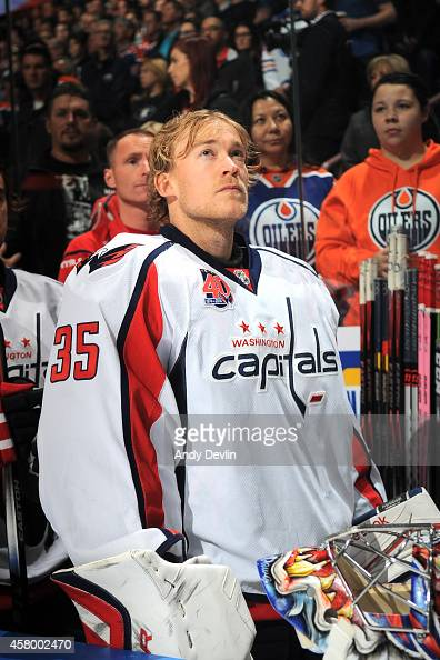 Justin Peters of the Washington Capitals stands for the singing of the national anthem prior to a game against the Edmonton Oilers on October 22 2014...