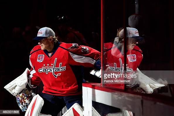 Justin Peters of the Washington Capitals steps onto the ice before the start of an NHL game against the Columbus Blue Jackets at Verizon Center on...