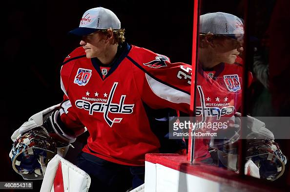 Justin Peters of the Washington Capitals steps onto the ice before the start of an NHL game against the Ottawa Senators at Verizon Center on December...