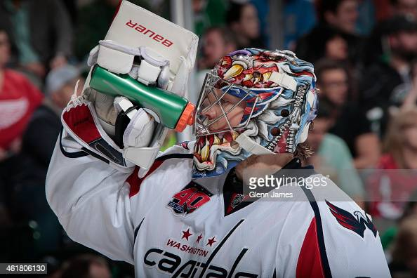 Justin Peters of the Washington Capitals takes a breather against the Dallas Stars at the American Airlines Center on January 17 2015 in Dallas Texas