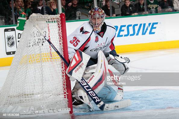 Justin Peters of the Washington Capitals tends goal against the Dallas Stars at the American Airlines Center on January 17 2015 in Dallas Texas