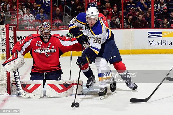 Justin Peters of the Washington Capitals watches Paul Stastny of the St Louis Blues control the puck in front of the net in the third period during...